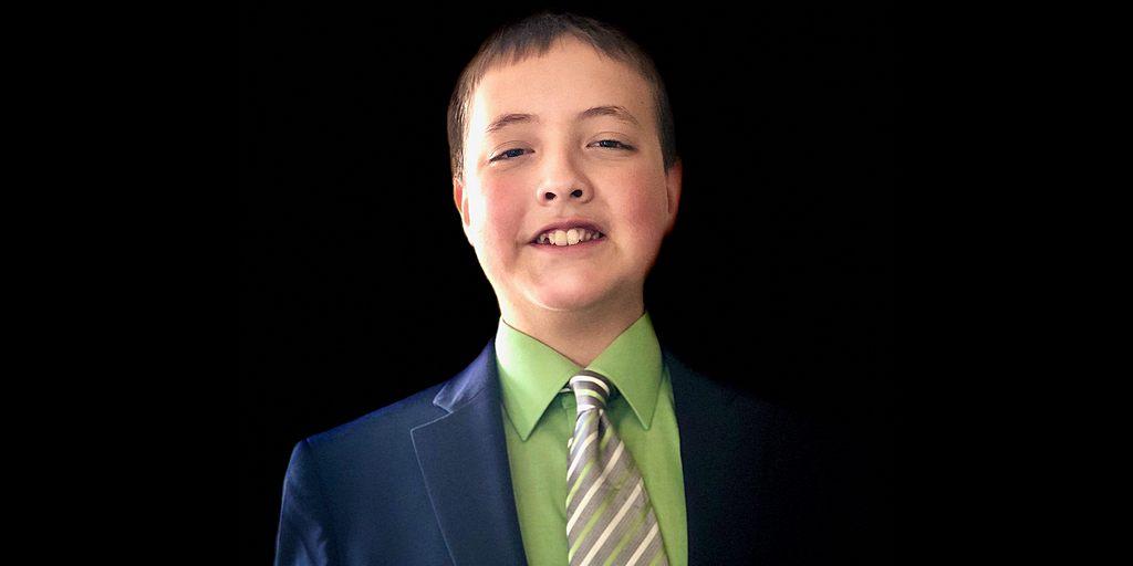 Самуэль Гирвен, 12 лет, служит помощником секретаря отдела коммуникации Церкви Кадиллак | Фото предоставлено: Стэнли Гирвен